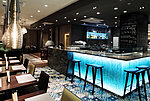 [Translate to Deutsch:] Blue-lit hotel bar at Gastronome Riga Restaurant