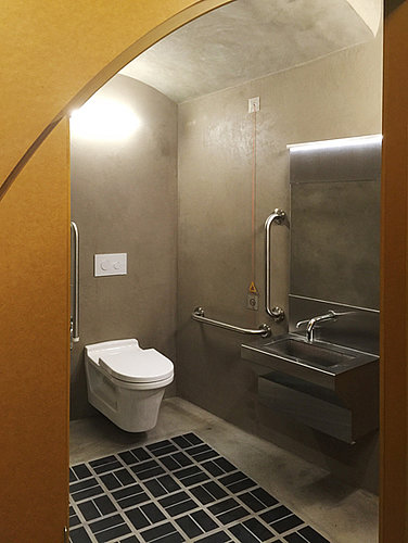 Public bathroom with rimless toilet at Building Centre London